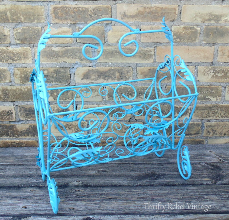 spray painted blue repurposed magazine rack planter