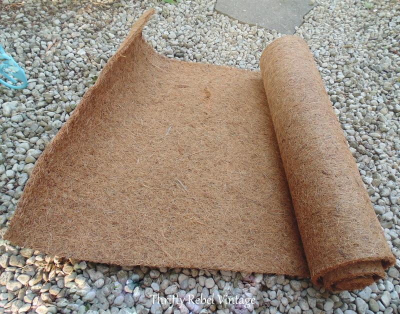 cocoa fibre for repurposed magazine rack planter
