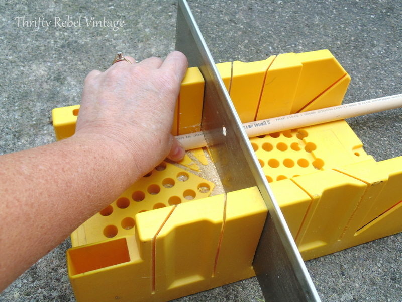 cutting pvc pipe into stems for diy tulips using mitre box and saw