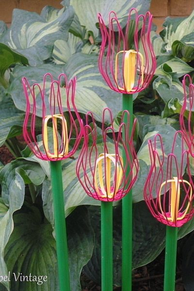 pink diy tulips made from repurposed gutter leaf strainers and beaters 2new