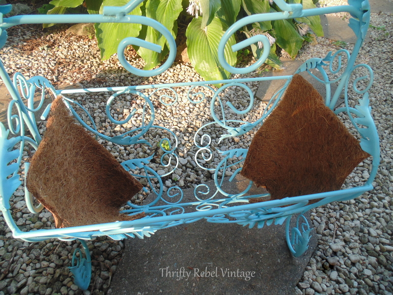 repurposed magazine rack planter ends lined with cocoa fibre