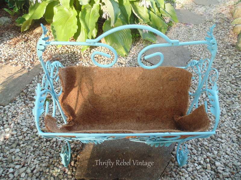 repurposed magazine rack planter inside lined with cocoa fibre