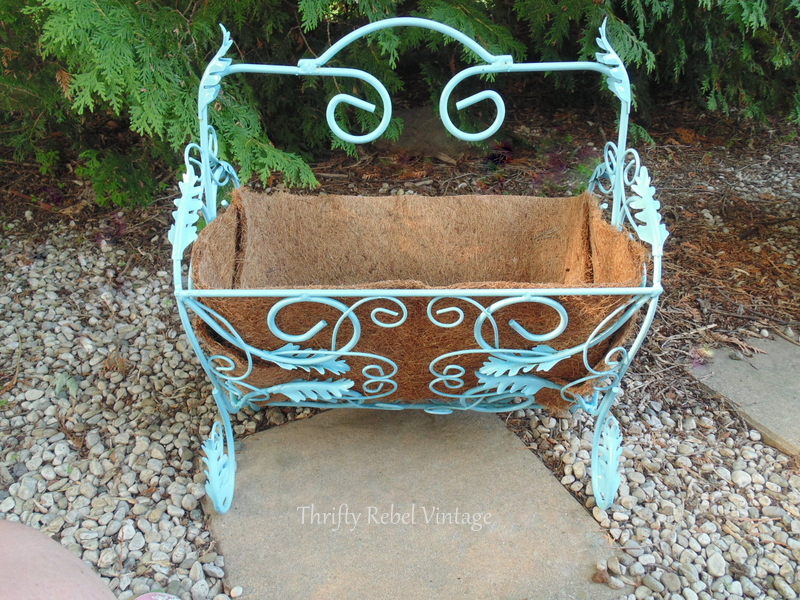 repurposed magazine rack planter lined with cocoa fibre