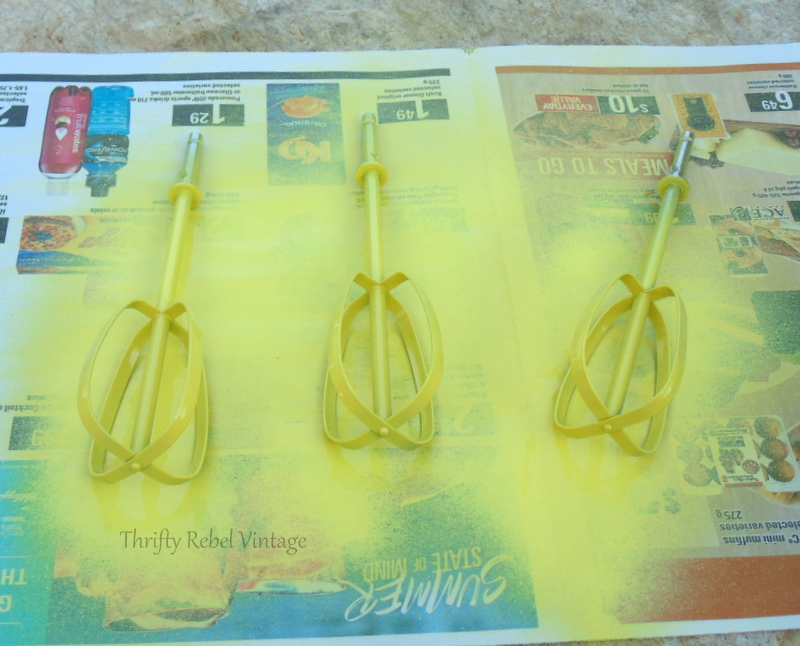 spray painting beaters yellow for repurposed gutter leaf strainer diy tulips