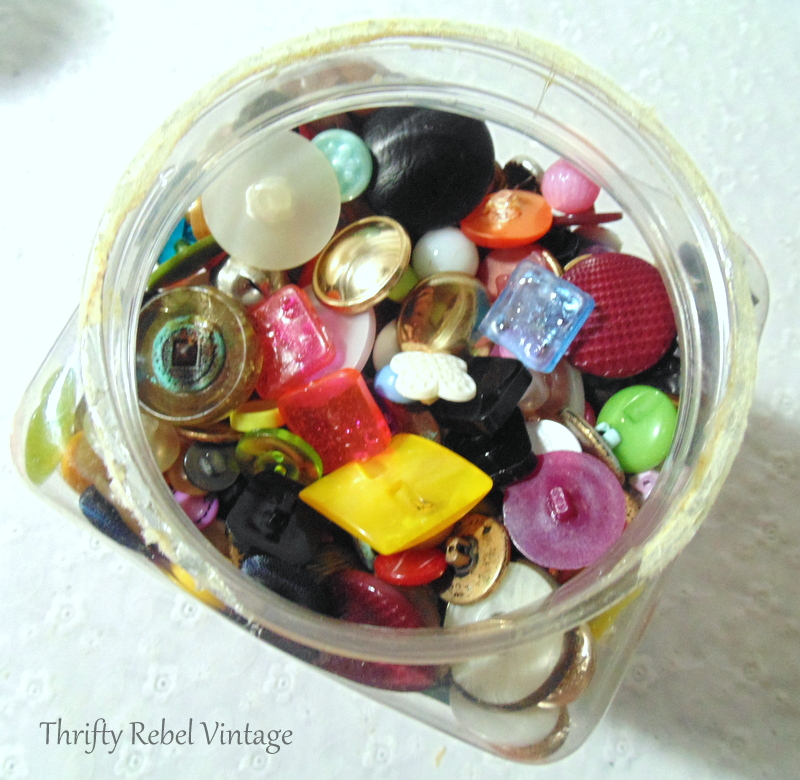 Container 3 of thrifted buttons for craft and repurposing projects