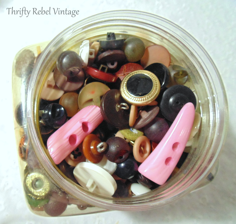 Container 4 of thrifted buttons for craft and repurposing projects