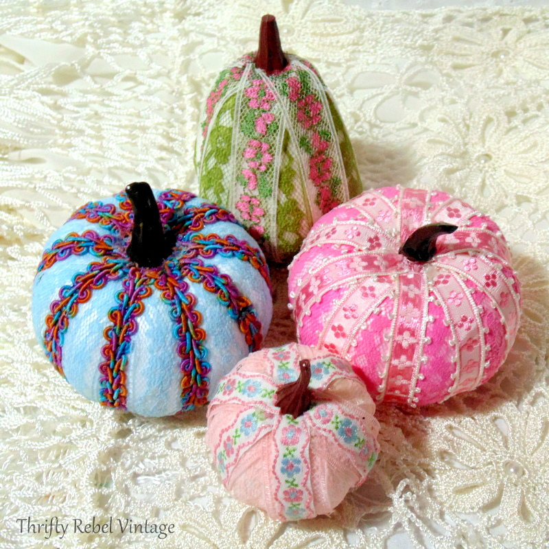Dollar store crafting pumpkin makeover into pretty lace and ribbon pumpkins