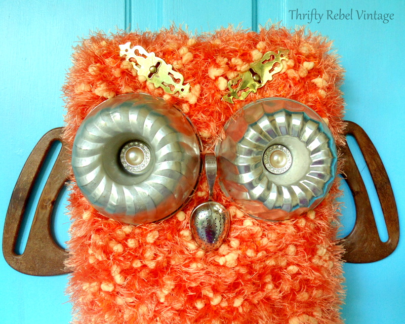 DIY repurposed owl with tote bag handle wings jello mold eyes spoon nose and scarf covered baking pan body