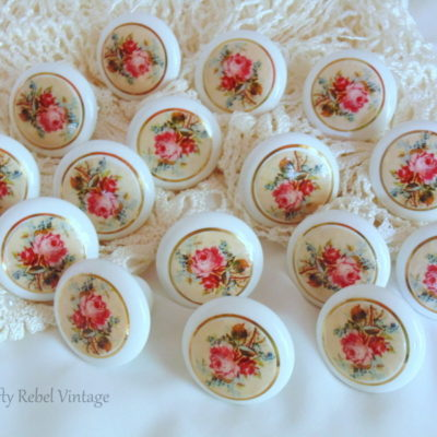 Decoupaged knobs with floral design to give them an update for a vintage dresser