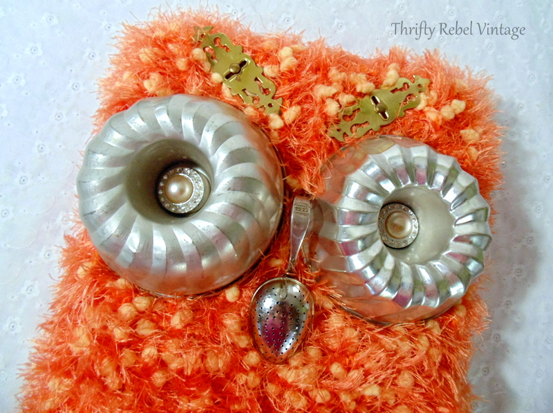 Gluing faux pearl earring into jello mold owl eyes and tea strainer onto teaspoon as owl nose