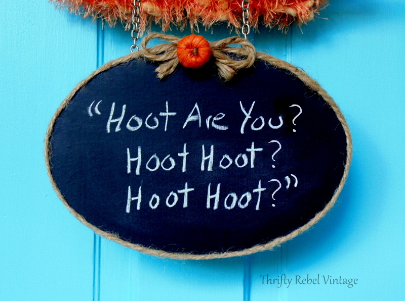 Hanging chalkboard sign with jute twine trim and bow and pumpkin detail from owl feet