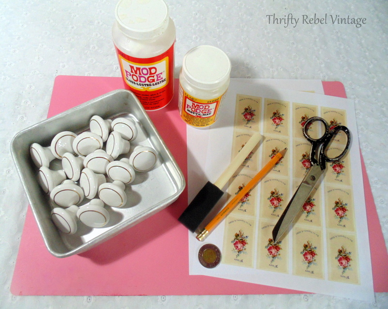 Supplies for decoupaged knobs to give an update to a vintage dresser