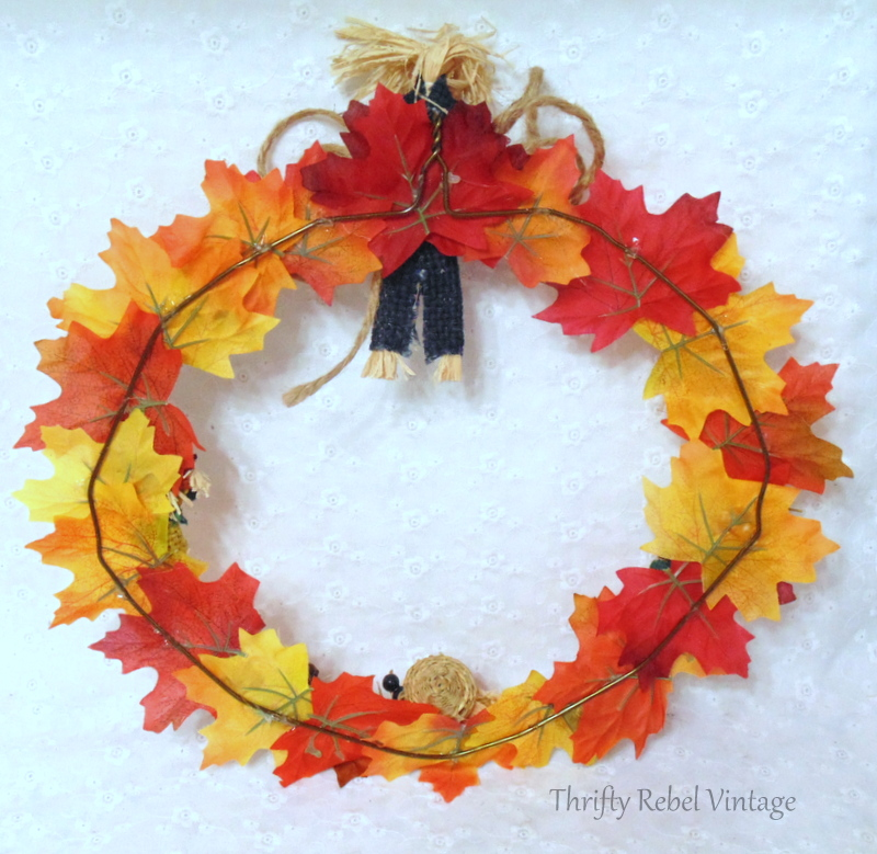 back of quick and easy fall wreath using repurposed hanger and faux leaves