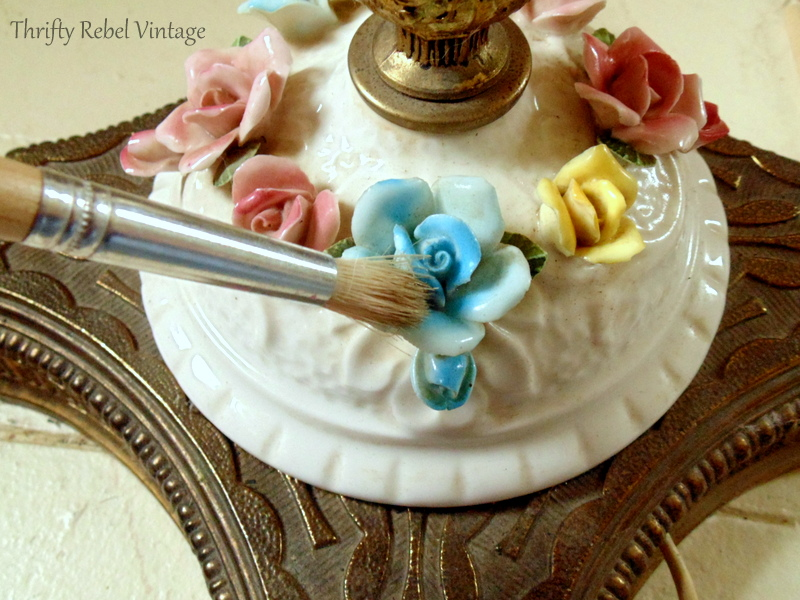 cleaning vintage bone china roses lamp with dry paint brush