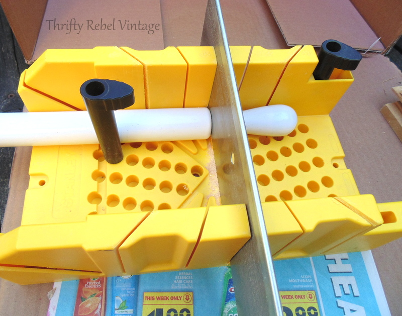 cutting paper towel holder using miter box and saw for diy tiered stand