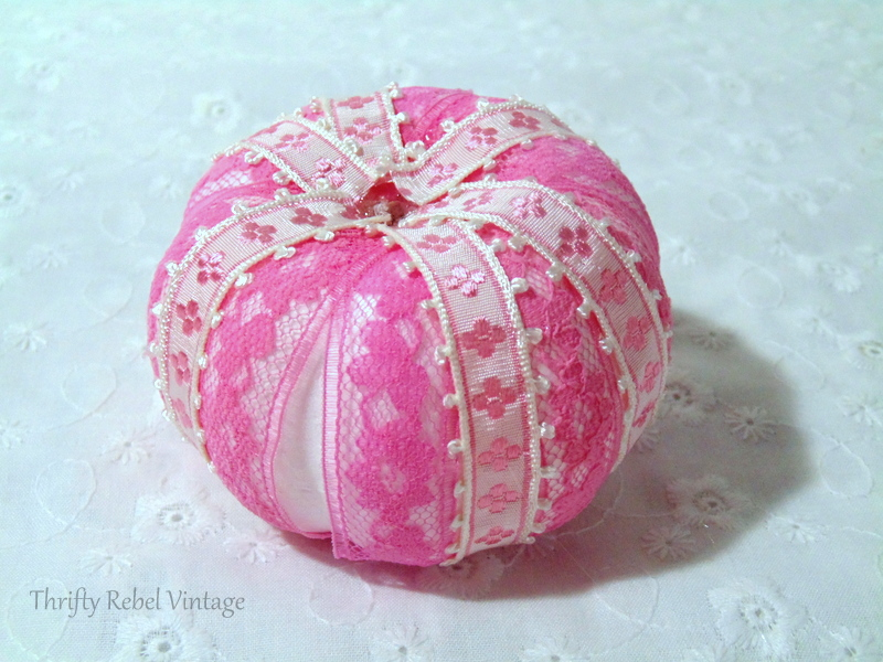 gluing pink ribbon between the pink lace for ribbon and lace pumpkins