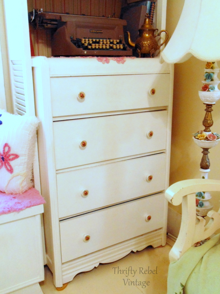 large dresser with new installed decoupaged knobs