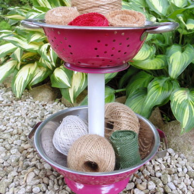 pink spray painted metal strainer diy tiered stand filled with jute and twine