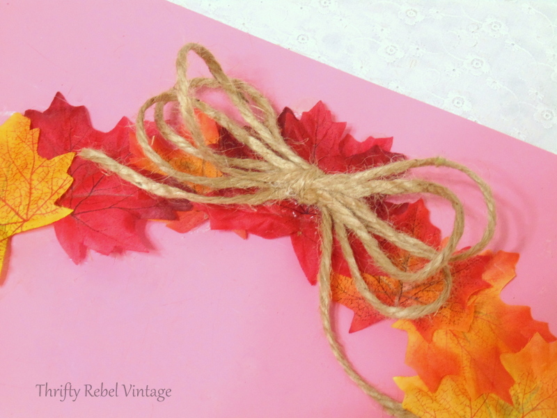 Adding a simple jute twine bow for top faux fall leaf wreath