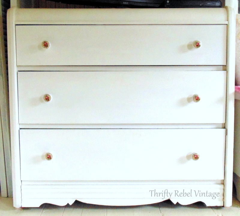 small dresser with new installed decoupaged knobs