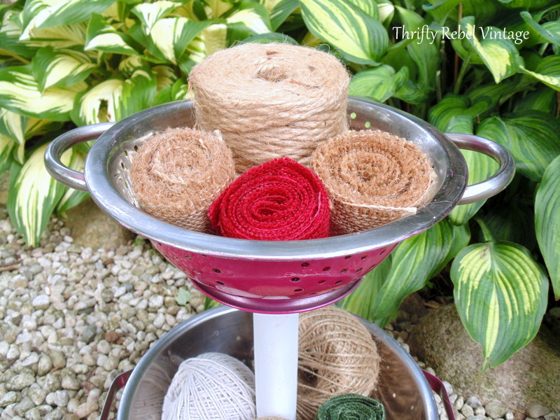 top strainer of diy tiered stand filled with jute twine and burlap ribbon