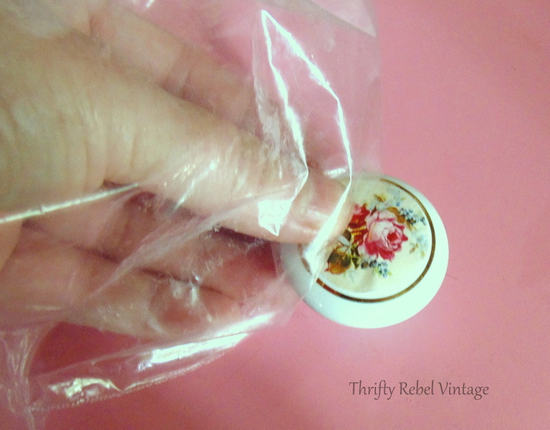 using plastic sandwich bag to apply rose paper design for decoupaged knobs