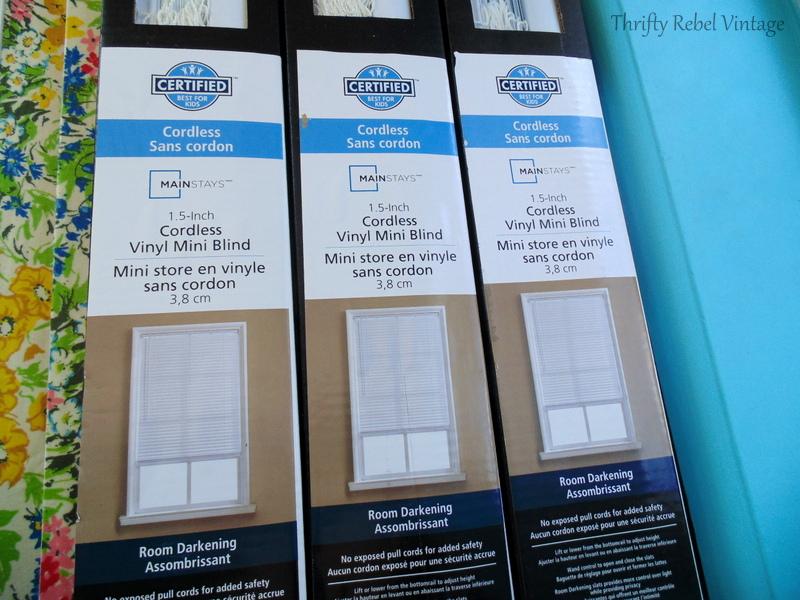 3 sets of white vinyl mini blinds for living room windows