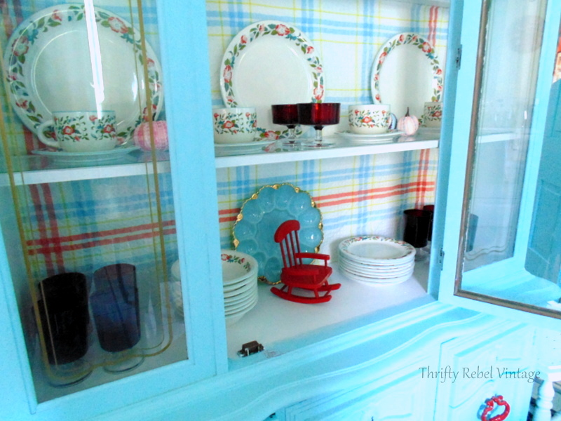 Crown Dynasty Dinnerware displayed in aqua china cabinet with vintage red glassware