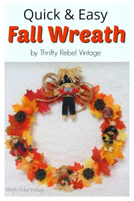 Quick & easy fall wreath using repurposed hanger and faux leaves