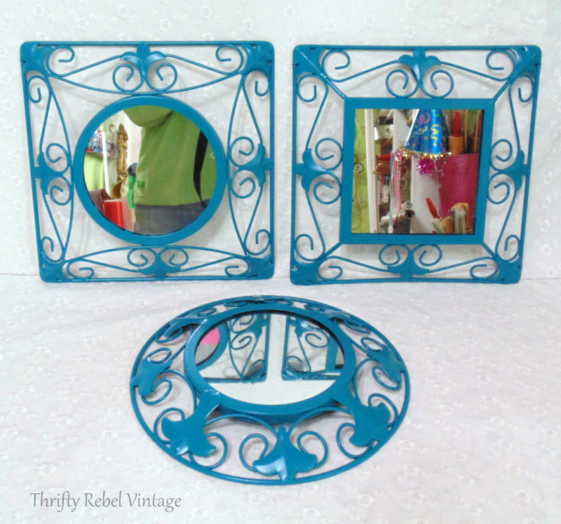 Three black wrought iron mirrors spray painted blue for repurposed mirror sign project