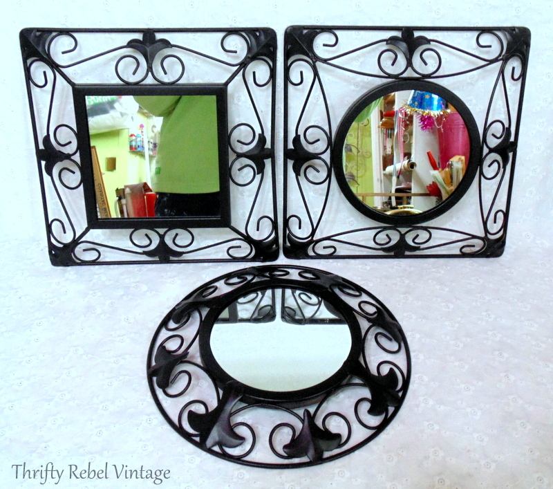 Three black wrought iron mirrors used to create a repurposed mirror sign
