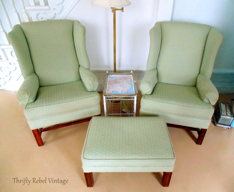 Set of 2 thrifted green wing chairs and ottoman