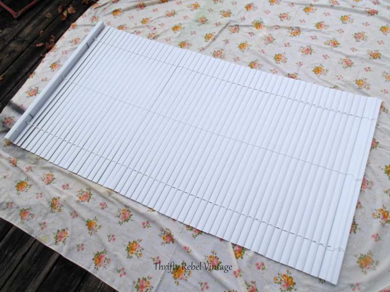 opening mini blind onto old sheet for spray painting