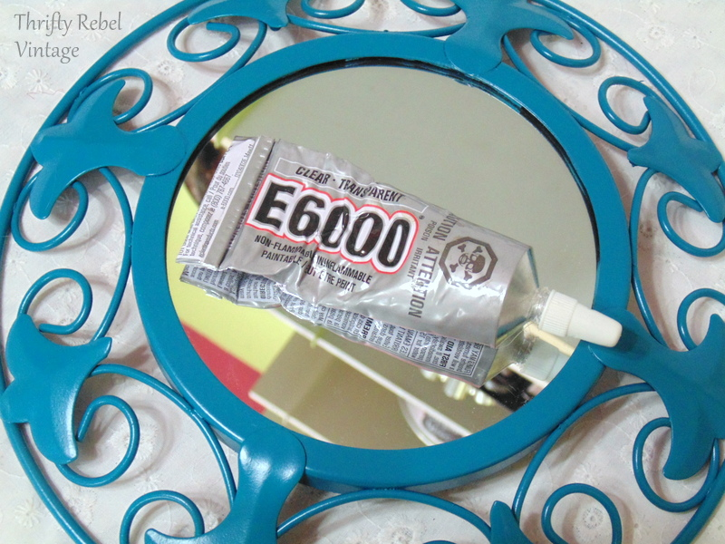 preparing to glue the buttons onto the mirrors with E6000 glue for repurposed mirror sign project