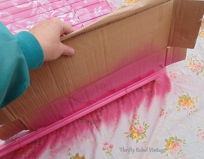 spray painting bottom rail of mini blind