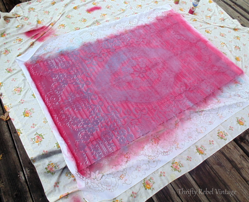 spray painting mini blind pink using lace tablecloth as stencil 3