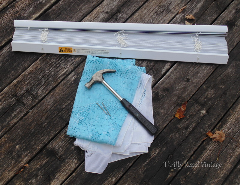 supplies for spray painting vinyl mini blind using a lace tablecloth as a stencil