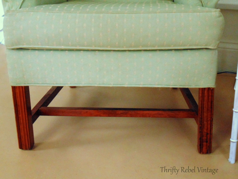 Wooden legs of green wing chair