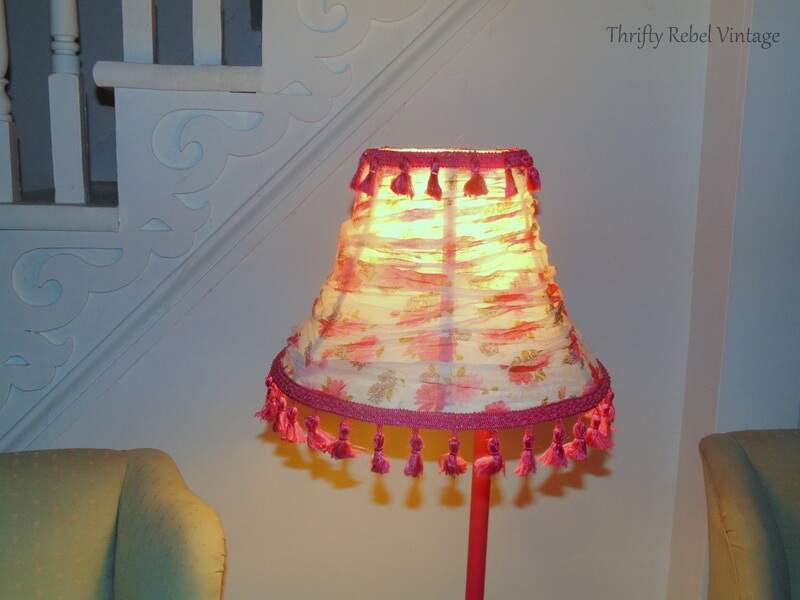 Floral scarf lampshade with light coming through the translucent scarf
