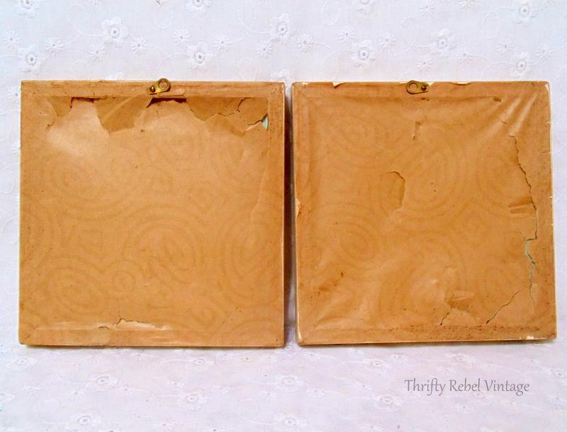 Paper covered backs of pair of small framed flower oil paintings on glass