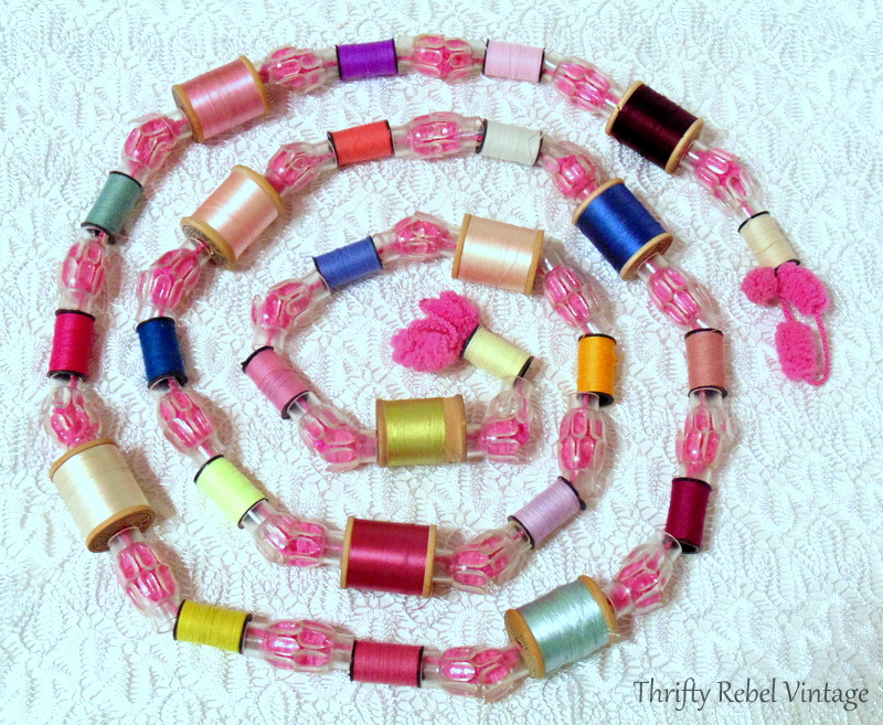How to make a garland using thread spools on puff ball yarn with clear light reflectors