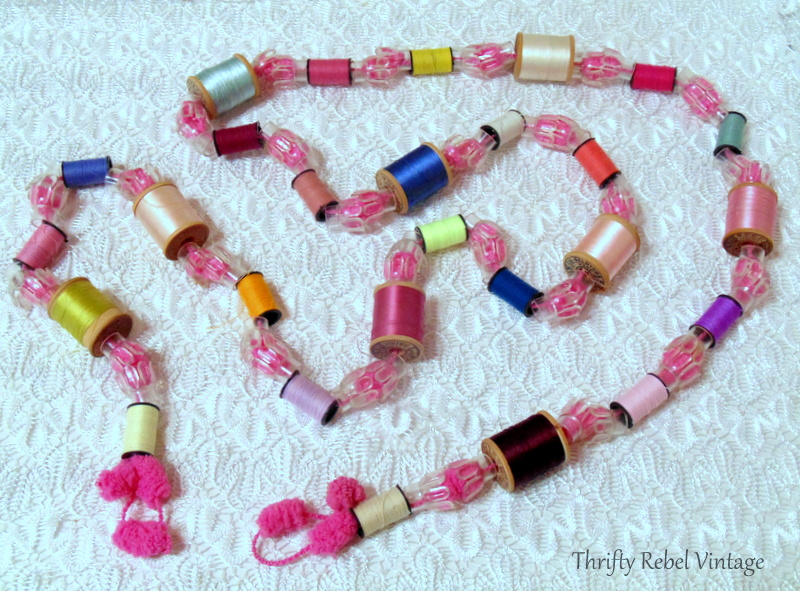 How to make a garland using thread spools with clear tree light reflectors on puff ball yarn 1