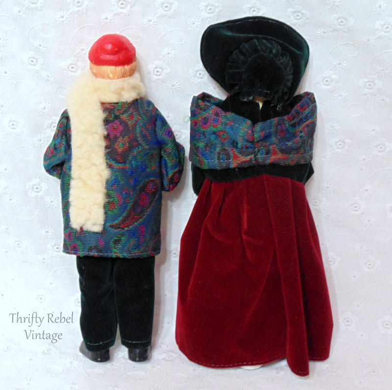 back of vintage boy and girl carollers dressed in period clothing