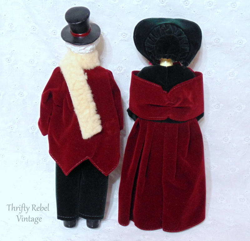 back of vintage man and woman carollers dressed in period clothing