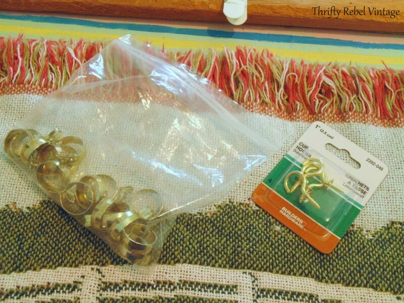 brass hooks and curtain clips used to turn throw into wall hanging