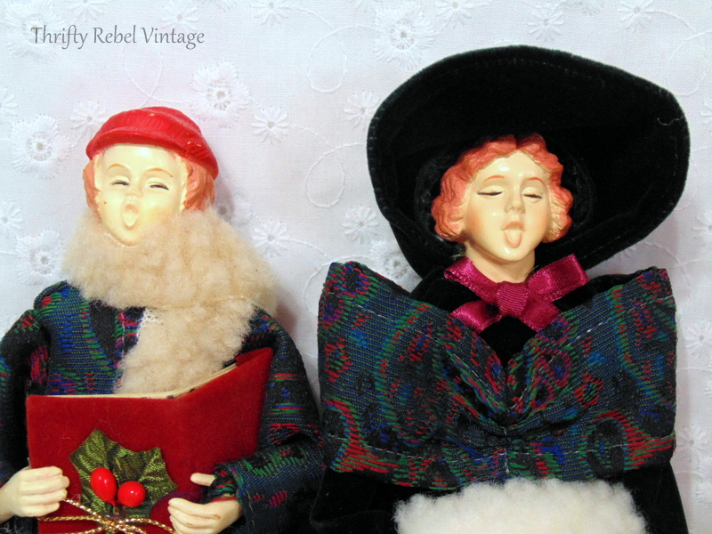 close up of faces of vintage boy and girl carollers dressed in period clothing