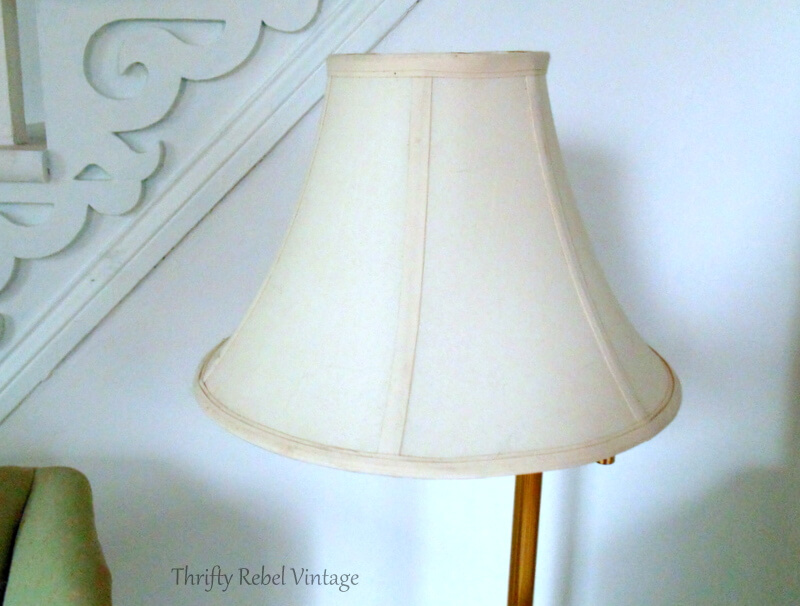 close up of living room white fabric lampshade on brass floor lamp
