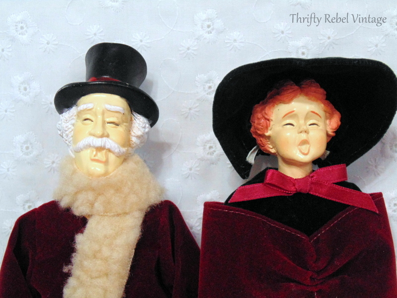 close up of the faces of vintage man and woman carollers dressed in period clothing