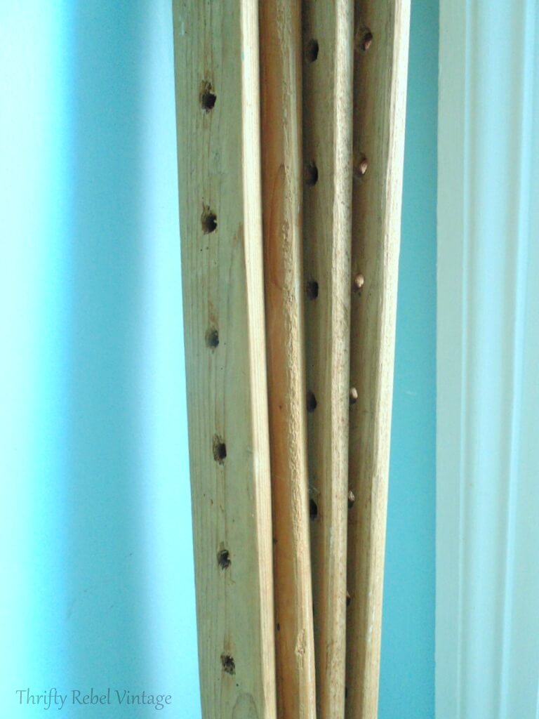 close up of vintage wooden quilt frame pieces for hanging Monet water gardens throw