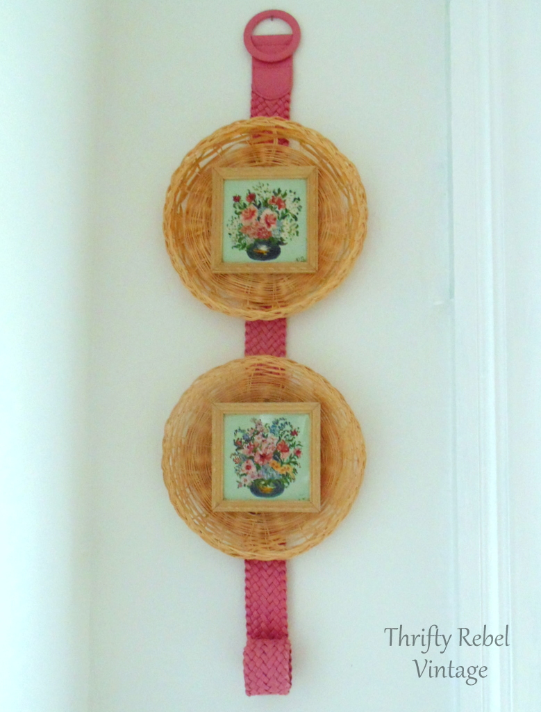 pair of mini flower paintings framed with wicker plates and hung on a belt